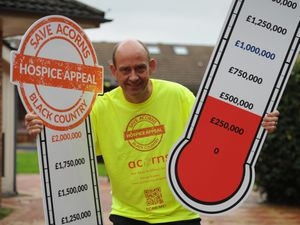 With cash thermometers, chief executive Toby Porter, at the Acorns Children's Hospice, Walsall
