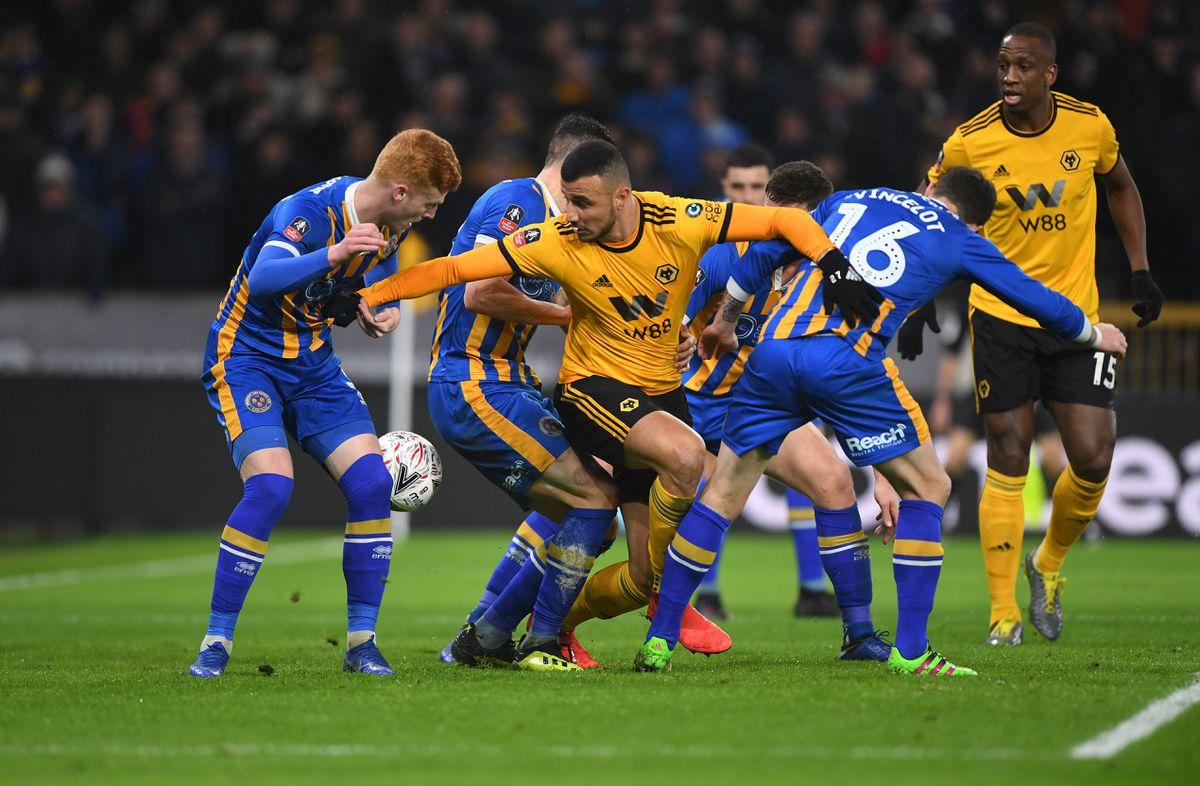Romain Saiss of Wolverhampton Wanderers and Romain Vincelot (AMA)