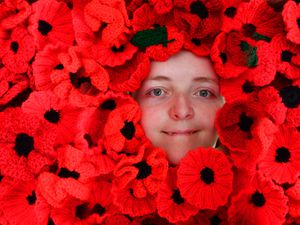 DUDLEY COPYRIGHT MNA MEDIA TIM THURSFIELD 20/10/21 .Brierley Hill Heritage Action Zone Team are appealing to people to knit, sew, crochet as many poppies as possible by the end of October to celebrate the Centenary of the Brierley Hill War Memorial..Pictured is Megan Smith, who is showing her support for the cause..