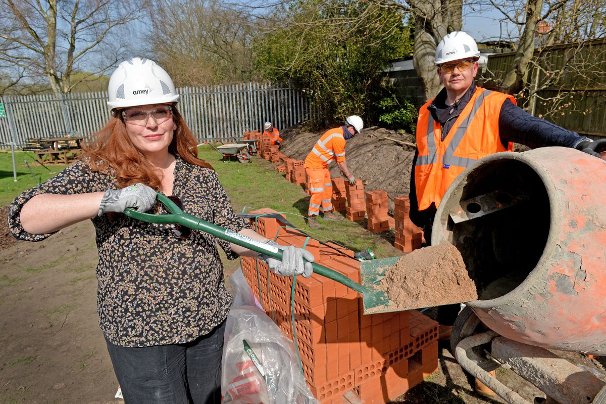Jane Stevenson MP and Wayne Brigden from Amey as the memorial garden is built after the British Legion raised cash online