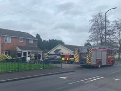 Woman rescued from severe flat fire which killed pet dog