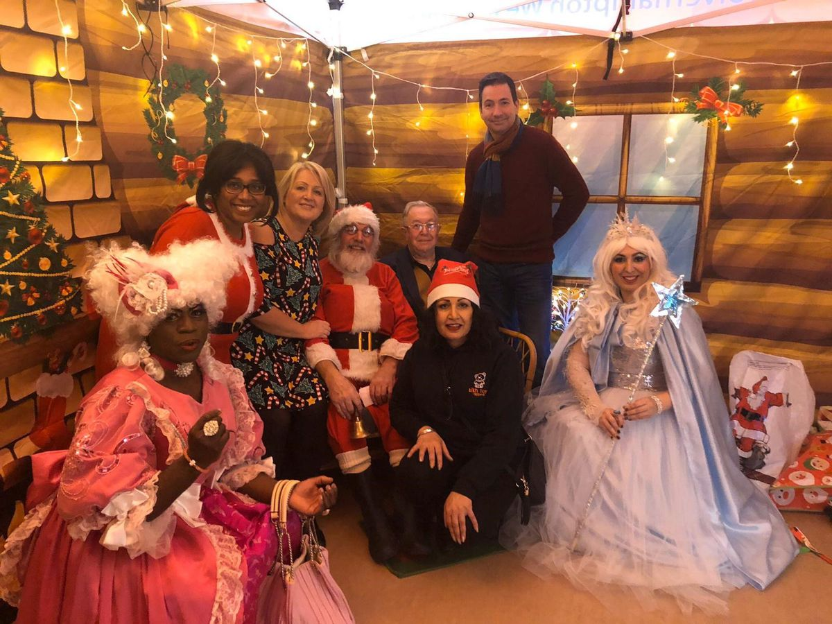 Dennis Ffrench, Cllr Olivia Birch, Cllr Linda Leach, Alan Jones from Sikh Toy Appeal, Cllr Phil Page, Jaz Sidhu from Sikh Toy Appeal, John Denley, Director of public Health, and Rebecca Shepherd