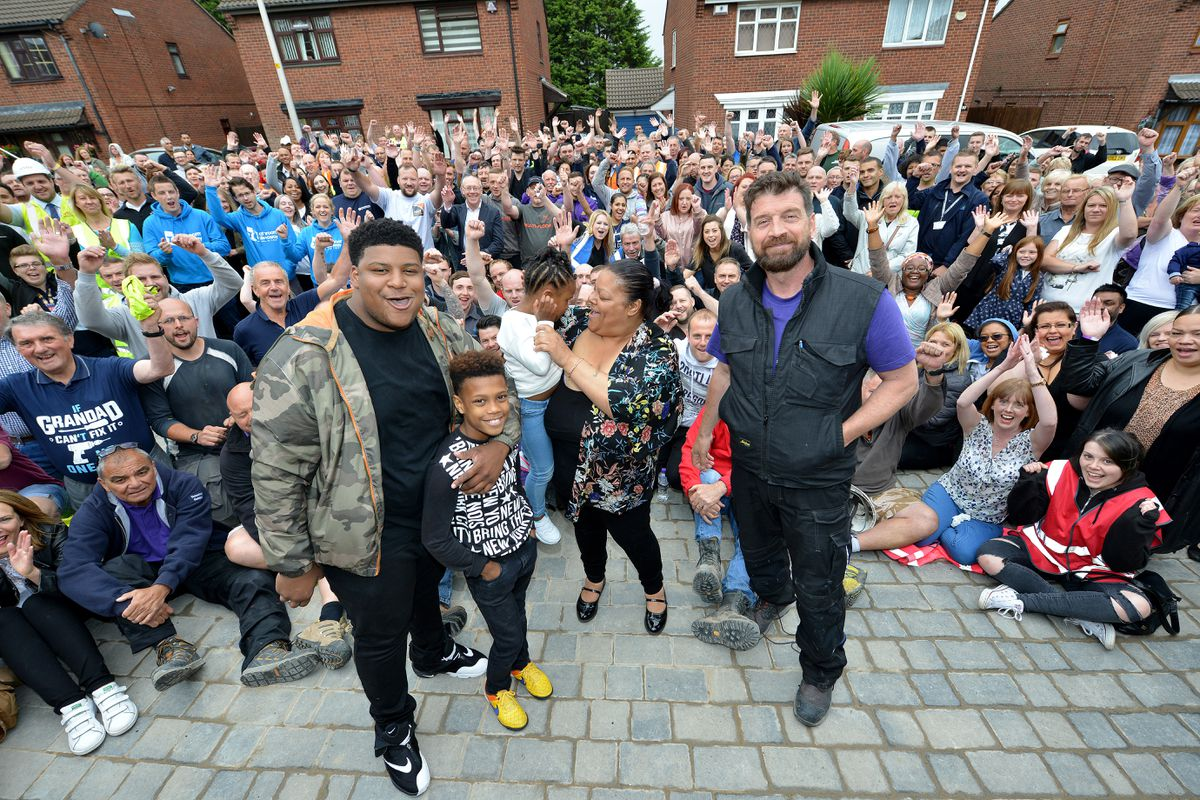 Presenter Nick Knowles joins family members and the DIY SOS team to celebrate the end of build