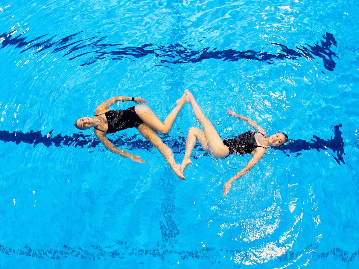 Synchronised swimmers make the most of the newly reopened London Aquatic Centre, at the Queen Elizabeth Olympic Park