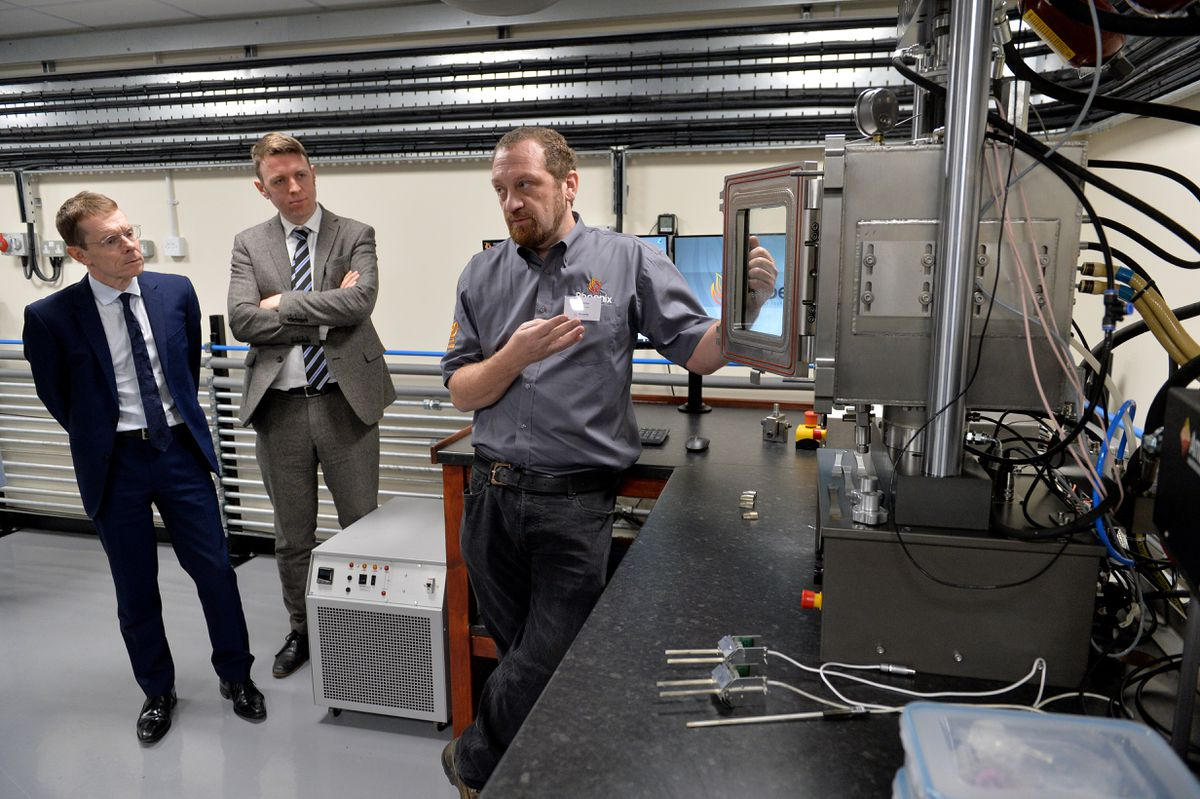 Andy Street is shown around the research facilities