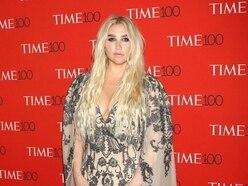 Kesha vows to 'love myself' after posting make-up-free selfie
