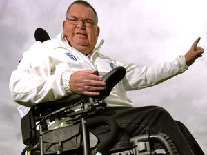 Shropshire cricket umpire John McIntear takes delivery of his specialist electric wheelchair