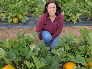 Anna Barton with some of the pumpkins grown for the festival