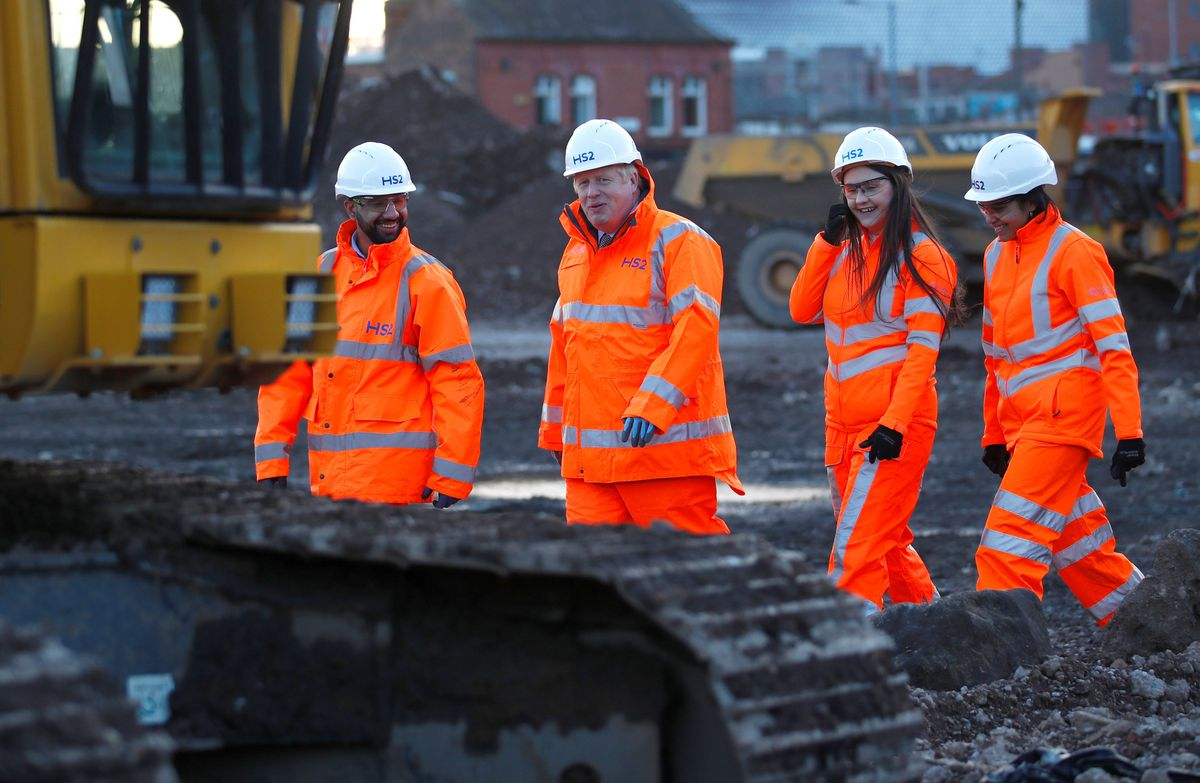 The Prime Minister walks with apprentices at the HS2 site at Curzon Street in Birmingham