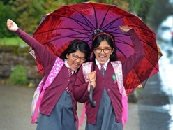 Sisters excited for the big return to school after six months at home