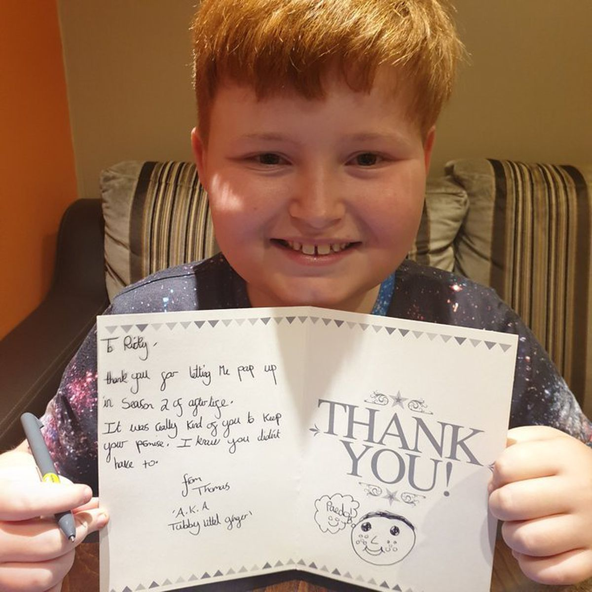 Thomas with his card, before sending it to Ricky Gervais - photo by Debbie Bastable