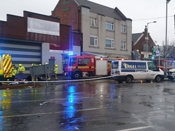 Woman trapped under lorry left badly injured