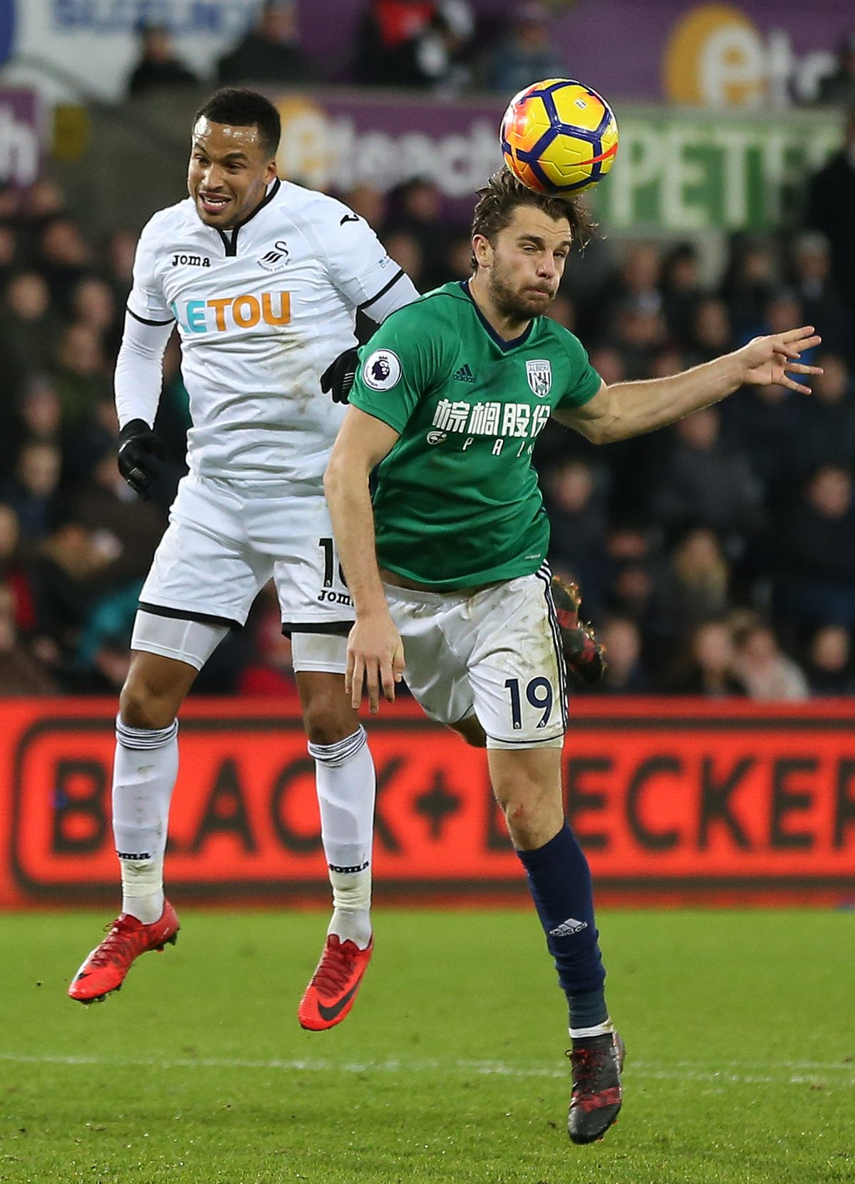 Martin Olsson of Swansea City and Jay Rodriguez of West Bromwich Albion. (AMA)
