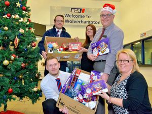 staff are pictured with just some of the food they have gathered for our 'Feed A Family Appeal'. Front L-R: Luke Southall, Hayley Chambers, Mel Knight (Service Development Manager), back L-R: Daniel Wildsmith and Lee Hickinbotham