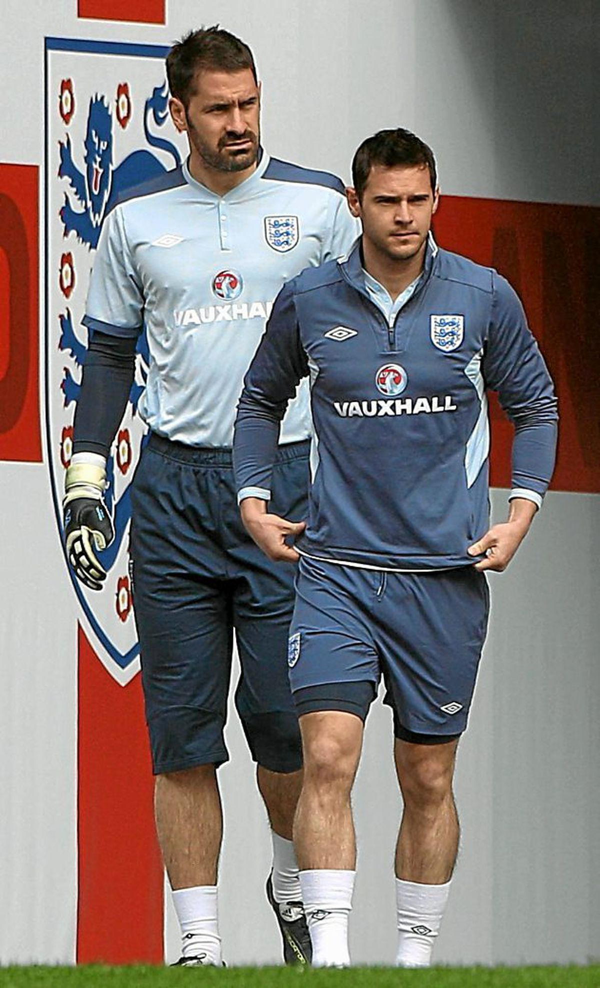England goalkeeper Scott Carson (left) and Matt Jarvis (right) walk out to a training session at Wembley Stadium,