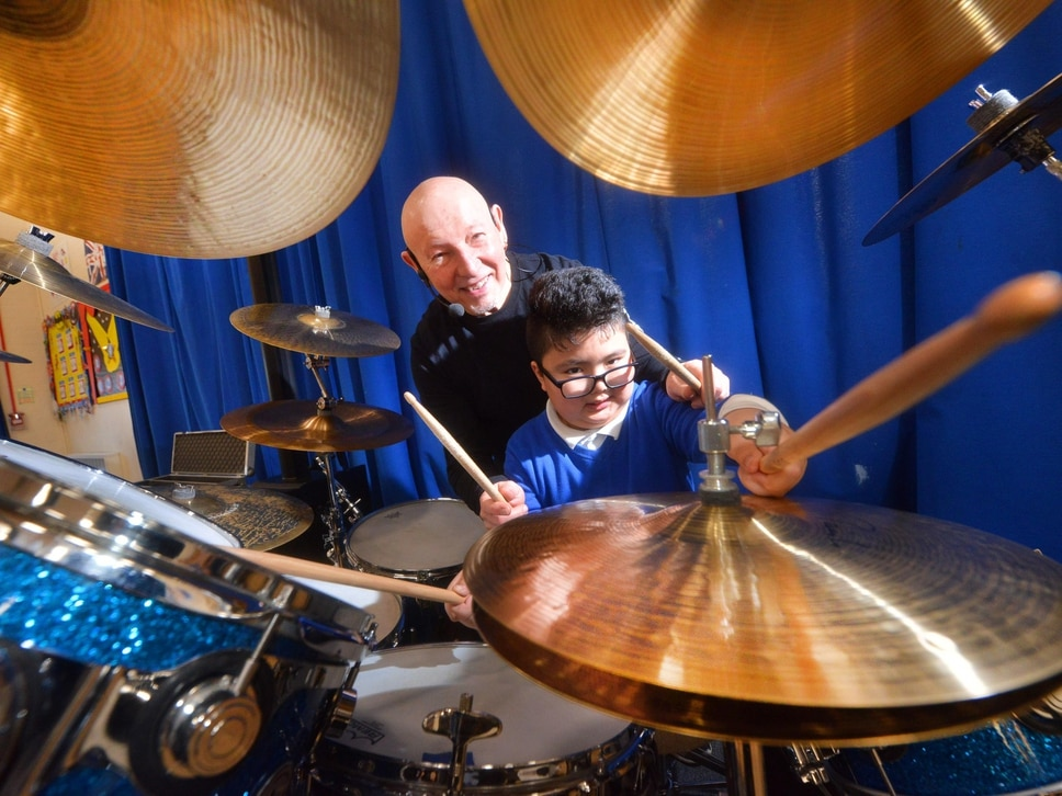 Tipton school pupils enjoy masterclass from Status Quo drummer