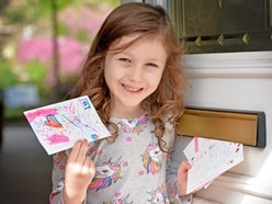 Young girl raises a smile among neighbours with colourful postcards