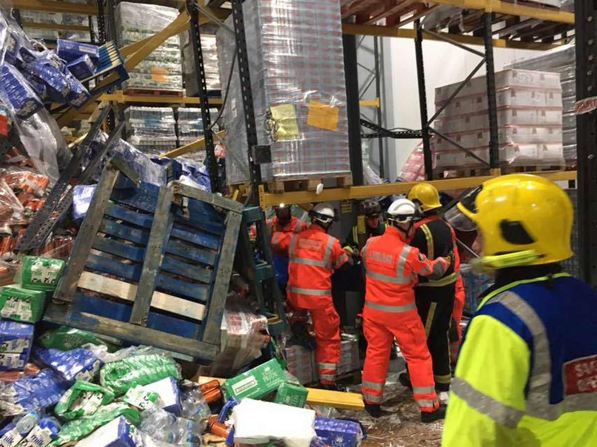 Rescuers at the warehouse. Photo: @TechRescueWMFS