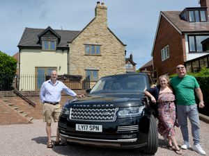 Paul and Lydia Browning, with Mike Chatha from Win Your Dream, outside the four-bedroom home up for grabs
