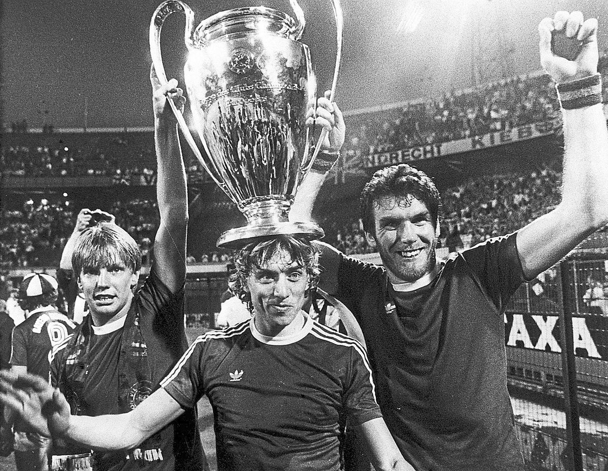 Villa's Tony Morley (centre) celebrates with the trophy after winning the European Cup final against Bayern Munich in 1982. The defence of their title began in front of an empty Villa Park