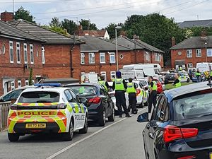 Officers carrying out the raid. Photo: Brierley Hill Police
