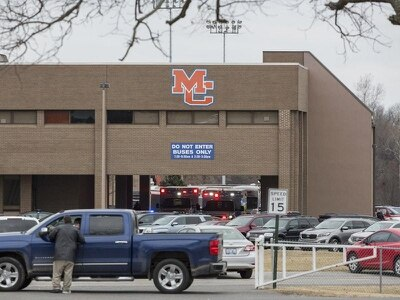 Boy, 15, in custody after two killed in US high school shooting