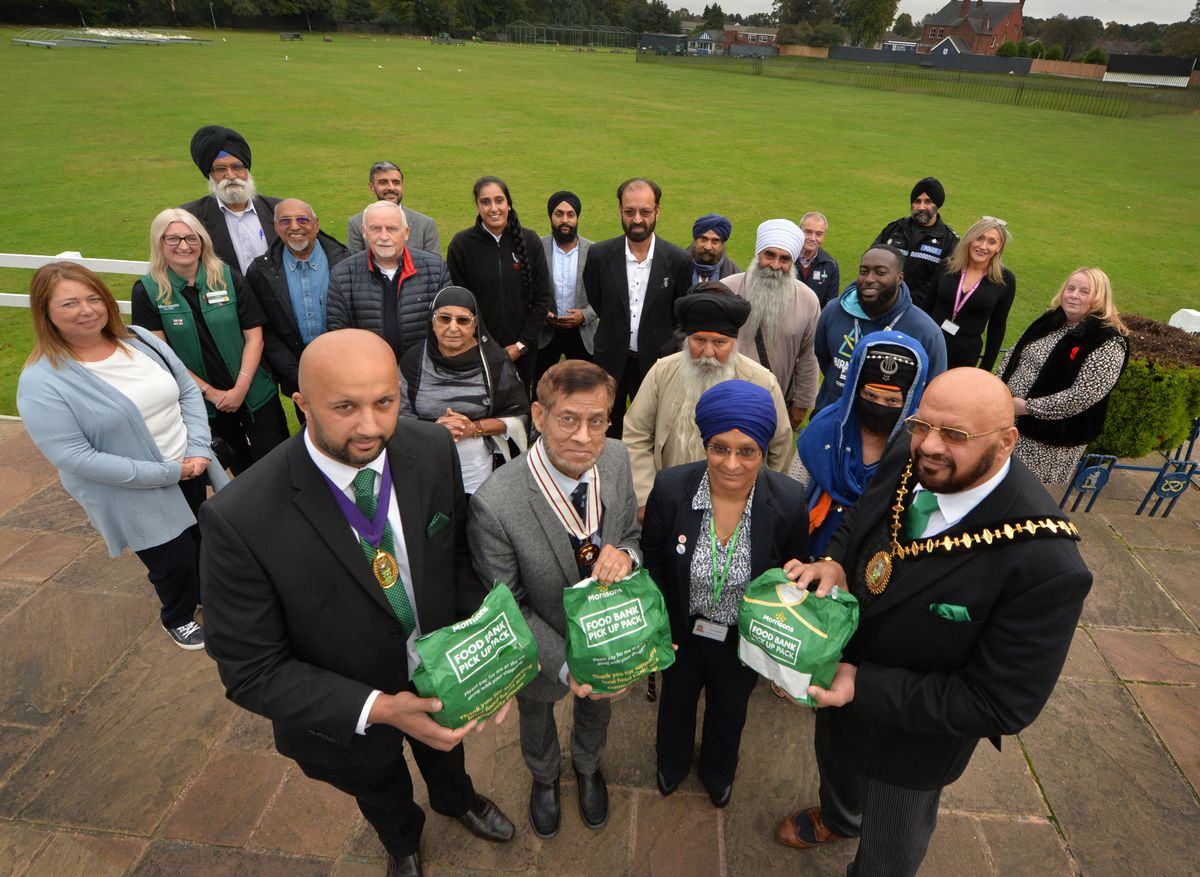 SANDWELL PIC MNA PIC  DAVID HAMILTON PIC  EXPRESS AND STAR 8/10/21 Attending the launch of Smethwick Foodbank, at Smethwick Cricket Club, founders and supporters including (front left-right) mayor of Sandwell consort Amar Mushtaq, deputy lieutenant Dr Sakhawat Hussain, councillor Parbinder Kaur, and mayor of Sandwell Mushtaq Hussain..