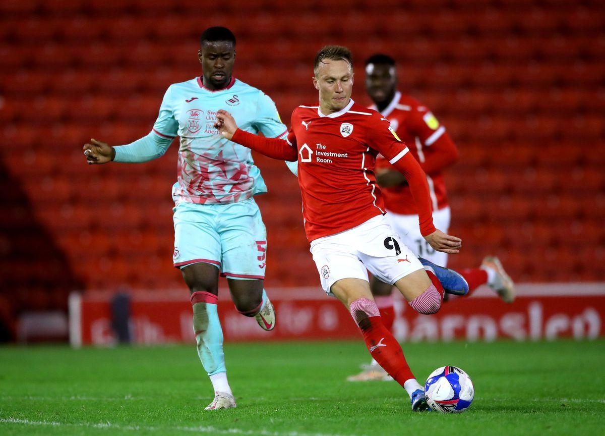 Swansea City's Marc Guehi (left) and Barnsley's Cauley Woodrow