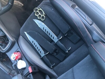 Machetes and knuckle dusters found in car search