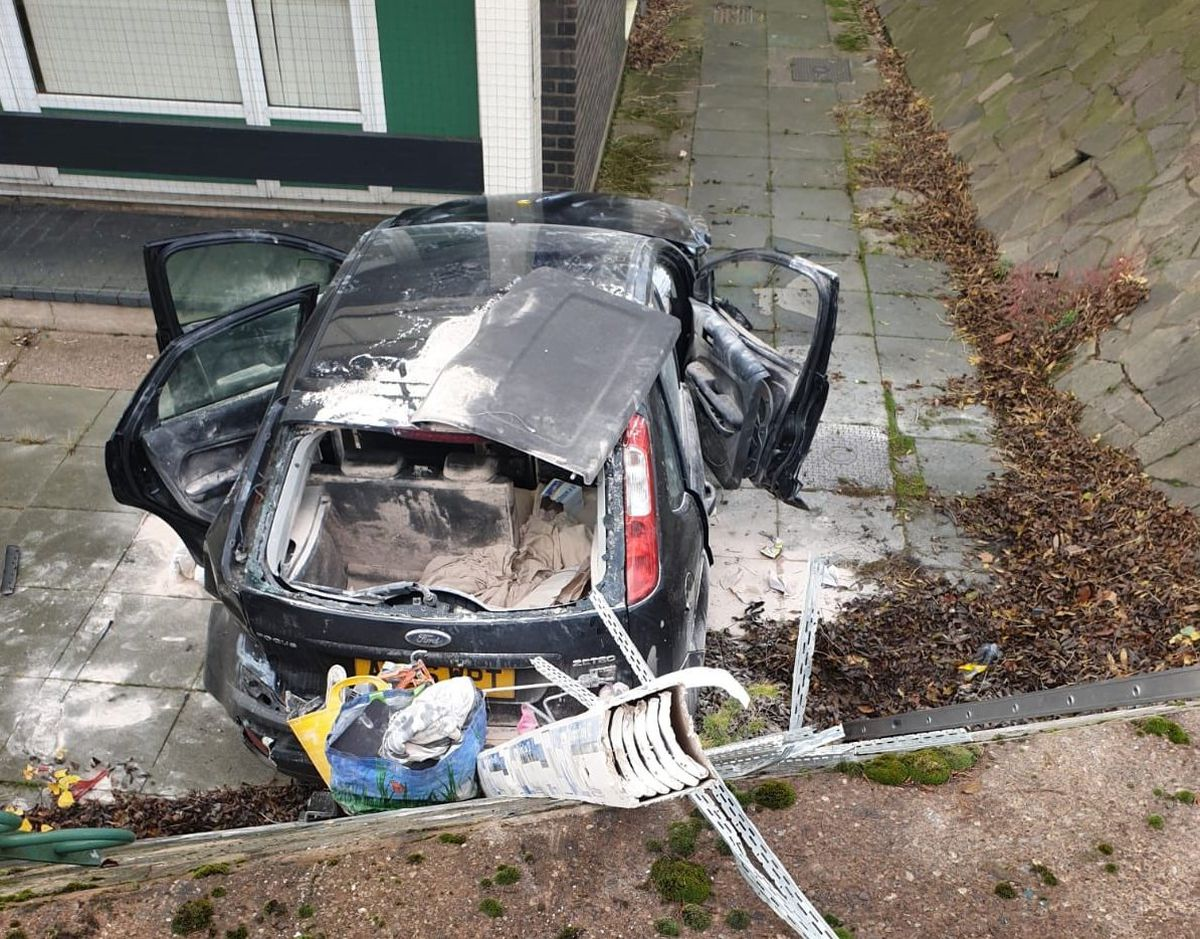 The vehicle was shunted off the road and down into the bank, where it hit the block of flats. Photo: Wolverhampton Fire