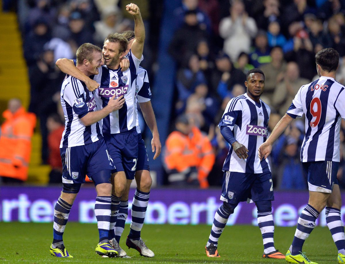 Gareth McAuley of West Bromwich Albion celebrates with Chris Brunt & Jonas Olsson of West Bromwich Albion after he heads from a corner to get the second goal making the final score 2-0 (ama)