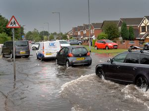 Flash flooding on Hednesford Road by Cannock Chase High School.