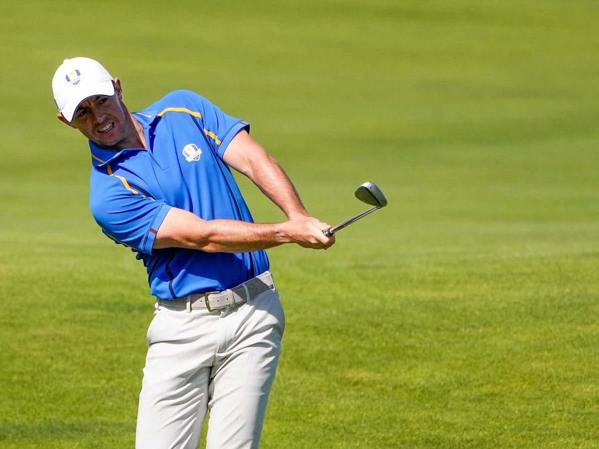Rory McIlroy hits to the fourth green