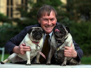 Sir David Amess with his pugs, Lily and Boat at the Westminster Dog of the Year competition in 2013. Photo: Geoff Caddick/PA Wire