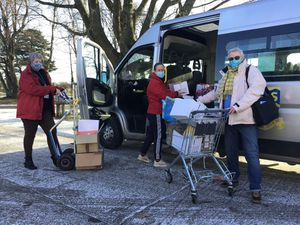 Stourport High staff (from left), administration lead Clare Whale, director of student services Kerry Maughan and PCSO Pat Roberts, loading the minibus with supplies