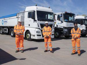 Some of the drivers from Tarmac's UK heavy goods vehicle fleet are Ian Slater, left, Malino Wilson and Gurnek Chanal, right