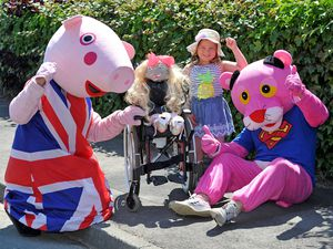 Stuart Bailey and Earl Edwards with five year old Amelia-Mae Smith, who has created a scarecrow in a wheelchair based on herself