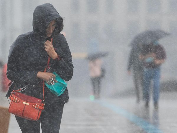 Woman caught in heavy rain