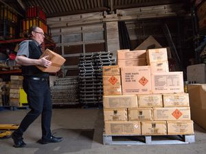 Chris Pearce, managing director of Jubilee Fireworks, packs up unsold boxes of fireworks ready to be sent back to storage