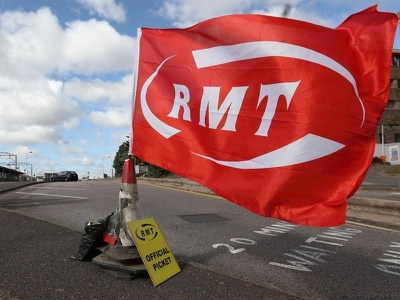 Rail workers vote for more strikes in dispute over guards