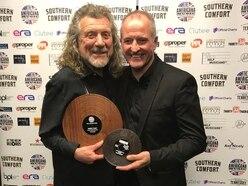 Wolves legend Steve Bull surprises Robert Plant with award - VIDEO
