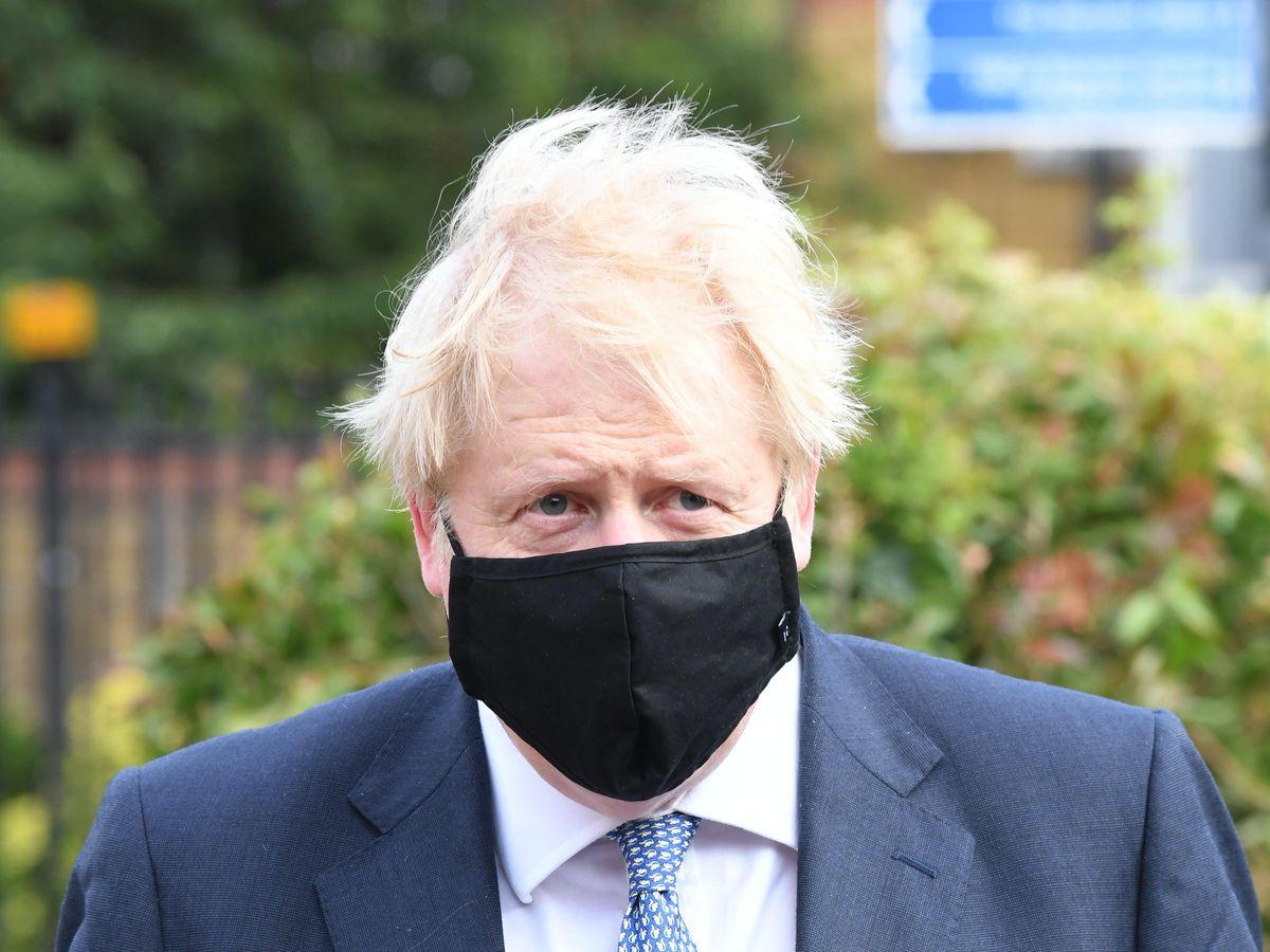 Boris Johnson wearing a face covering
