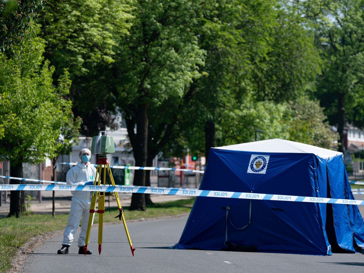 A forensics officer at the scene on College Road, Kingstanding, where Dea-John Reid was killed