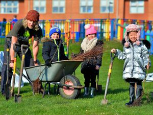 Nick Wale from Forest Schools Birmingham and pupils Isaac Westbury aged six, Ruby Kafeel aged six and Jessica Wang aged six