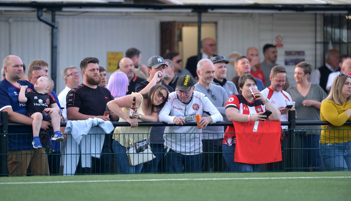 Supporters watching on