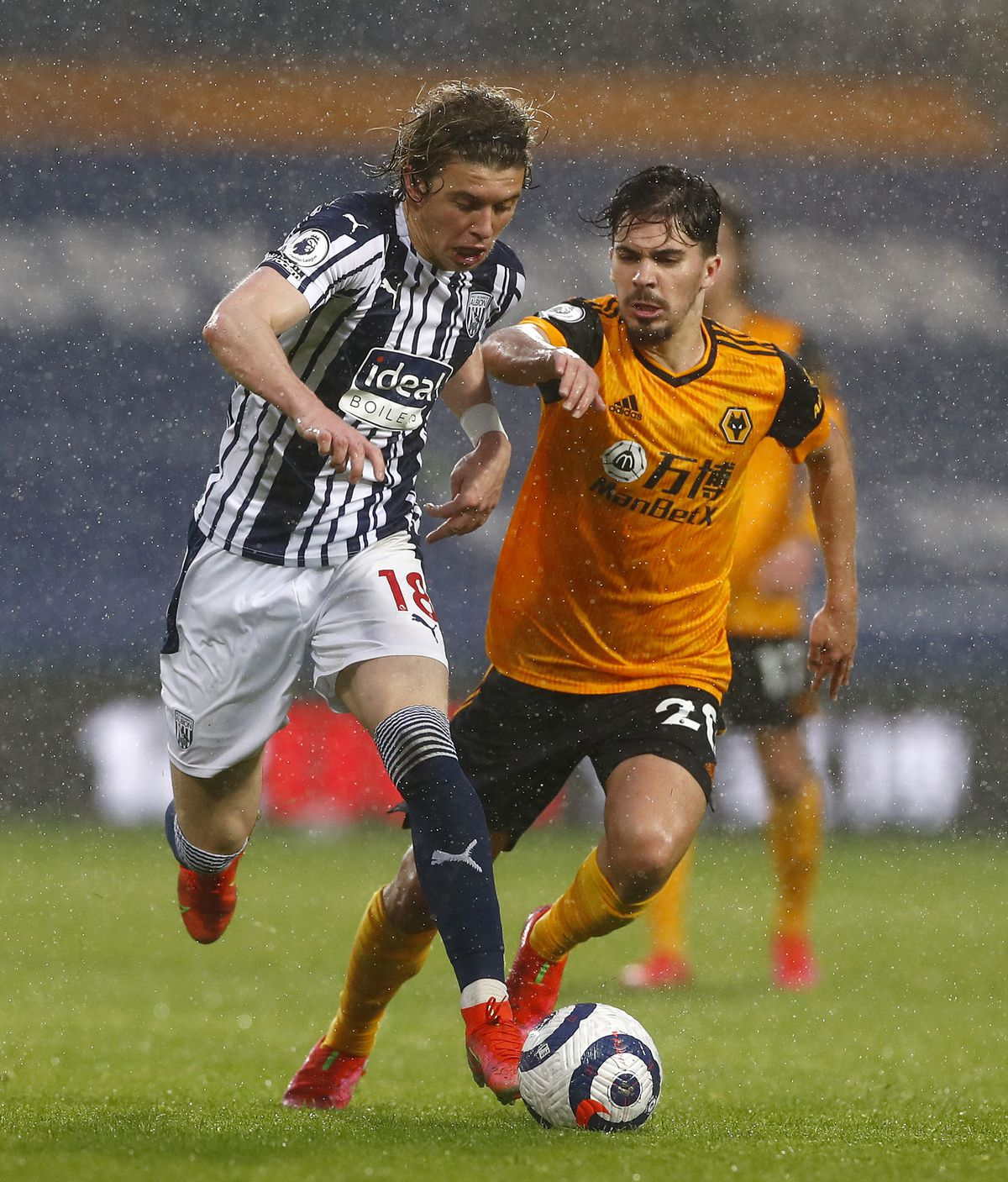 """West Bromwich Albion's Conor Gallagher (left) and Wolverhampton Wanderers' Vitinha during the Premier League match at The Hawthorns, West Bromwich. Issue date: Monday May 3, 2021. PA Photo. See PA story SOCCER West Brom. Photo credit should read: Jason Cairnduff/PA Wire. ..RESTRICTIONS: EDITORIAL USE ONLY No use with unauthorised audio, video, data, fixture lists, club/league logos or """"live"""" services. Online in-match use limited to 120 images, no video emulation. No use in betting, games or single club/league/player publications.."""