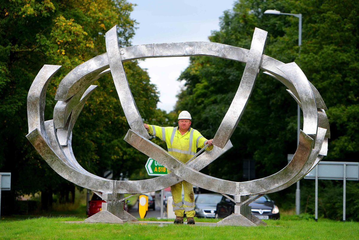 Karl Hall from Brierly Hill who works for Midlands Road Maintenance stands by the new sculpture in the Beacon Business Park.