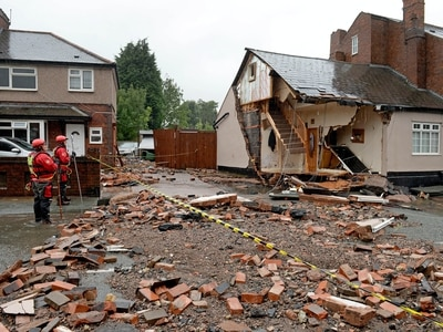 WATCH: Home damaged after burst water main floods road