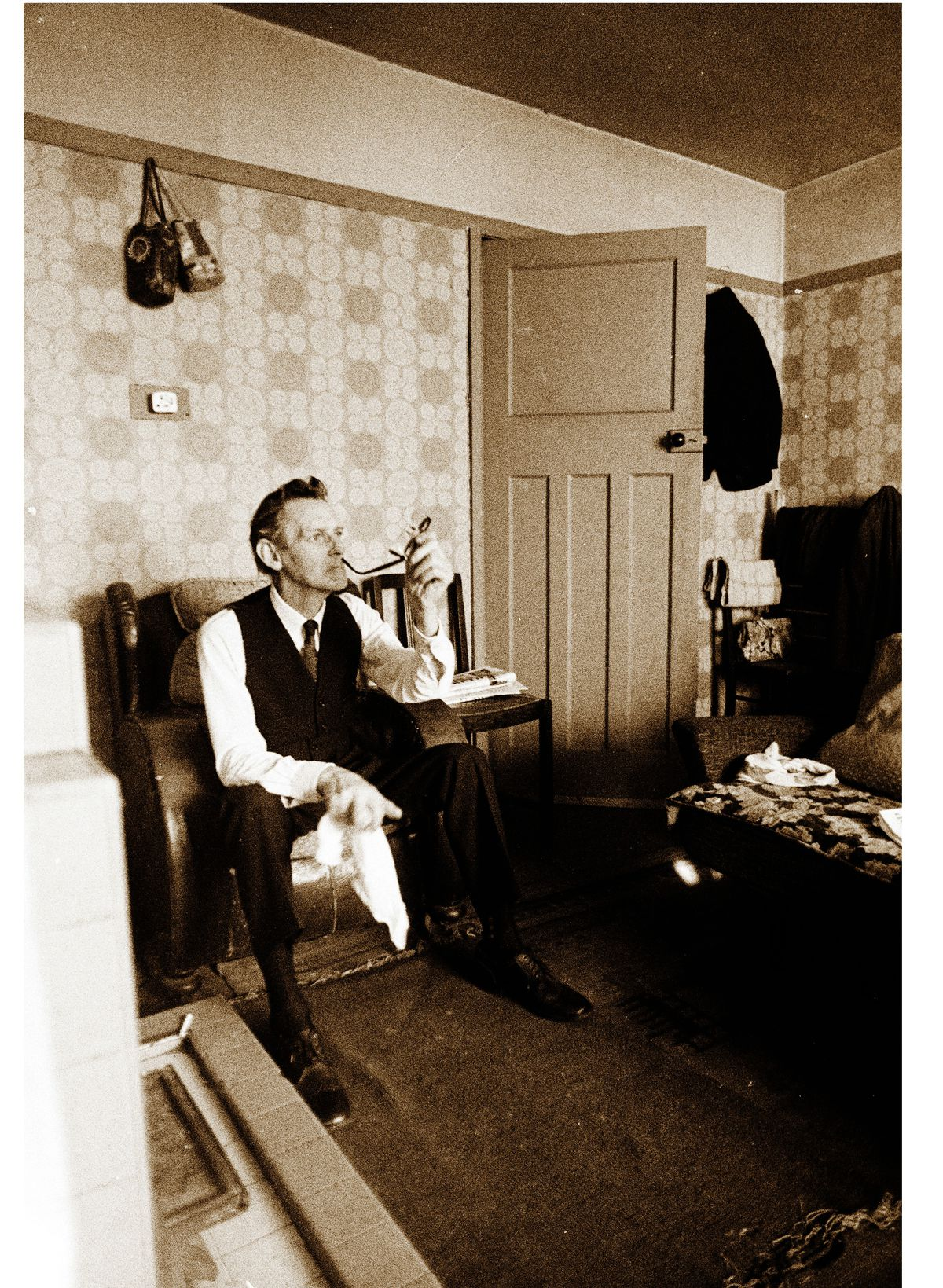 A smartly dressed man in his home on The Scotlands