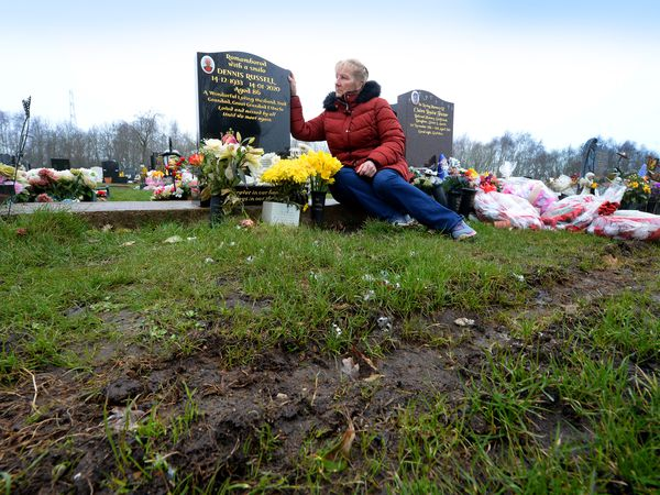 Beverley Hutt at the grave of her father Dennis Russell at North Walsall Cemetery